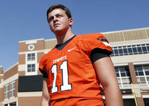photo - Quarterback Wes Lunt waits to have his picture taken during Oklahoma State's football media day in Stillwater, Okla., Saturday, Aug. 4, 2012. Photo by Sarah Phipps, The Oklahoman