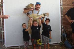 Photo - Team Bite Me's Justin Taylor at the 2011 Okie Noodling Tournament. PHOTO PROVIDED <strong></strong>