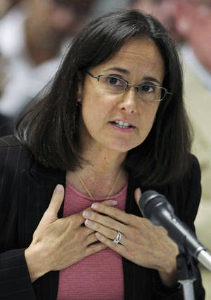 Photo - FILE - In this Sept. 10, 2009 file photo, Illinois Attorney Gen. Lisa Madigan speaks in Chicago. Madigan is trying to salvage Illinois' ban on concealed carry. She said Tuesday, Jan. 8, 2013, that she has filed a petition asking that all 15 judges on the U.S. 7th Circuit Court of Appeals review a lawsuit challenging the ban. Last month, a three-judge panel struck down the ban on carrying concealed weapons in Illinois _ the only remaining state where doing so is entirely illegal. (AP Photo/M. Spencer Green, File)