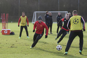 Photo - Manchester United's Wayne Rooney, centre left, trains with teammates at Carrington training ground in Manchester, Monday, Dec. 9, 2013.  Manchester United will play Shakhtar Donetsk in a Champion's League Group A soccer match on Tuesday. (AP Photo/Jon Super)