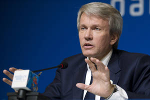 Photo - President of the the National Paralympic Committee of Ukraine Valeriy Suskevich holds out his hands during a press conference before the closing ceremony of the 2014 Winter Paralympics in Sochi, Russia, Sunday, March 16, 2014. (AP Photo/Pavel Golovkin)