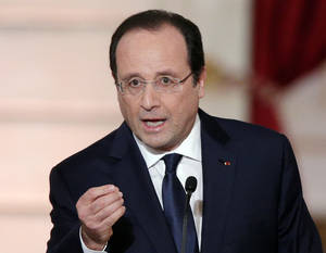 "Photo - FILE - In this Tuesday, Jan. 14, 2014 file photo, French President Francois Hollande delivers his speech at his annual news conference, at the Elysee Palace in Paris. Authorities say the mother of a pupil at a French pre-school stabbed a teacher to death in front of her class Friday, July 4, 2014, the last day of the school year. French President Francois Hollande expressed outrage at ""this abominable drama"" at the Edouard Herriot school in Albi in southern France. (AP Photo/Christophe Ena, File)"