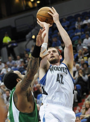 photo -   Minnesota Timberwolves' Kevin Love, right, gove up for a shot as Maccabi Haifa's James Thomas defends in the first half of an NBA exhibition basketball game against the Israeli team, Tuesday, Oct. 16, 2012 , in Minneapolis. Love led the Timberwolves with 24 points in their 114-81 win. (AP Photo/Jim Mone)