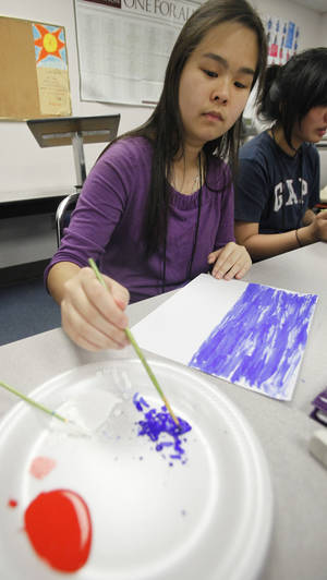 Photo - Nikki Vu, 15, paints during her art class in Oklahoma City Community College's Upward Bound program. Photos By Steve Gooch, The Oklahoman