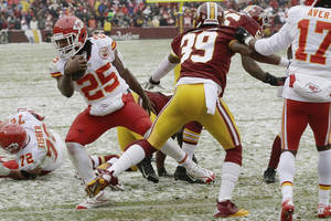 Photo - Kansas City Chiefs running back Jamaal Charles breaks free from Washington Redskins free safety David Amerson to score a touchdown during the first half of an NFL football game in Landover, Md., Sunday, Dec. 8, 2013. (AP Photo/Pablo Martinez Monsivais)
