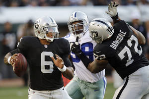 Photo -   Oakland Raiders quarterback Terrelle Pryor (6) looks to pass as offensive tackle Joe Barksdale (72) blocks Dallas Cowboys defensive end Kenyon Coleman (99) during the second half of an NFL preseason football game in Oakland, Calif., Monday, Aug. 13, 2012. (AP Photo/Ben Margot)