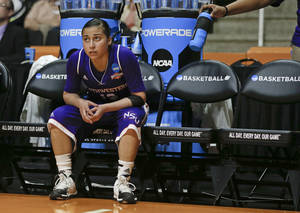 Photo - Northwestern State guard Janelle Perez watches from the bench in the second half of an NCAA women's college basketball first-round tournament game against, Tennessee Saturday, March 22, 2014, in Knoxville, Tenn. Tennessee won 70-46. (AP Photo/John Bazemore)