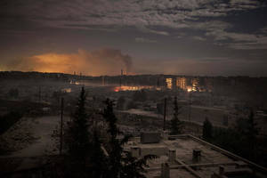 photo - In this Saturday, Dec. 1, 2012 photo, smoke rises from buildings due to heavy fighting between Free Syrian Army fighters and government forces in Aleppo, Syria. (AP Photo/Narciso Contreras)