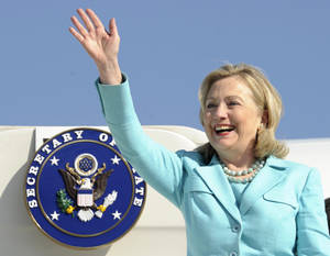 photo - FILE - In this June 10, 2011 file photo, Secretary of State Hillary Rodham Clinton waves as the arrives at Lusaka International Airport in Lusaka, Zambia. Clinton has been admitted to a New York hospital after the discovery of a blood clot stemming from the concussion she sustained earlier this month. Spokesman Philippe Reines says her doctors discovered the clot during a follow-up exam Sunday, Dec. 30, 2012. (AP Photo/Susan Walsh, Pool, File)
