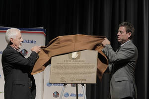 "Photo - Former high school football coach Rick Enis and pro football legend Troy Aikman unveil the historic Allstate Pro Football Hall of Fame ""Hometown Hall of Famers"" plaque at Henryetta High School today where the plaque will live to serve as an inspiration to future students and the Henryetta community. Photo courtesy of Allstate"