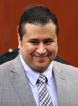 Photo - George Zimmerman smiles during a recess during his trial in Seminole circuit court in Sanford, Fla., Monday, June 17, 2013. Zimmerman has been charged with second-degree murder for the 2012 shooting death of Trayvon Martin.(AP Photo/Orlando Sentinel, Joe Burbank, Pool)