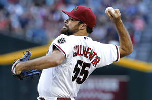 Photo - Arizona Diamondbacks pitcher Josh Collmenter throws against the Cincinnati Reds during the first inning of a baseball game, Thursday, May 29, 2014 in Phoenix. (AP Photo/Matt York)