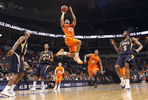 Photo - OSU's James Anderson drives to the basket during the Cowboys' 77-62 win over La Salle on Monday in the All-College Classic at the Ford Center.  PHOTO BY CHRIS LANDSBERGER, THE OKLAHOMAN