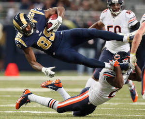 Photo - St. Louis Rams tight end Jared Cook (89) is tackled by Chicago Bears safety Major Wright in the fourth quarter of an NFL football game on Sunday, Nov. 24, 2013, in St. Louis. (AP Photo/St. Louis Post-Dispatch, Chris Lee)  EDWARDSVILLE INTELLIGENCER OUT; THE ALTON TELEGRAPH OUT