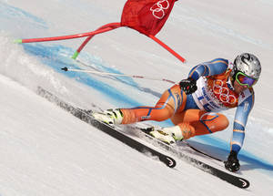 Photo - Norway's Aksel Lund Svindal passes a gate in the men's super-G at the Sochi 2014 Winter Olympics, Sunday, Feb. 16, 2014, in Krasnaya Polyana, Russia. (AP Photo/Charles Krupa)