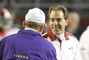 photo - Alabama head coach Nick Saban right, speaks with LSU head coach Les Miles before an NCAA college football game Saturday, Nov. 5, 2011, in Tuscaloosa, Ala. Saban and Miles both voted in the coaches' poll this season. (AP Photo/Butch Dill)