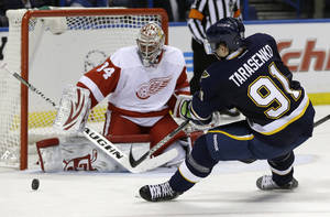 photo - St. Louis Blues' Vladimir Tarasenko, of Russia, shoots just wide of Detroit Red Wings goalie Petr Mrazek, left, of the Czech Republic, during the second period of an NHL hockey game Thursday, Feb. 7, 2013, in St. Louis. (AP Photo/Jeff Roberson)