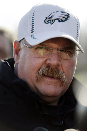 Photo - Philadelphia Eagles coach Andy Reid speaks with members of the media during a news conference at the team's NFL football training facility, Wednesday, Dec. 19, 2012, in Philadelphia. (AP Photo/Matt Rourke)