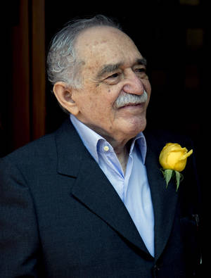 "Photo - FILE - In this March 6, 2014, file photo, Colombian Nobel Literature laureate Gabriel Garcia Marquez greets fans and reporters outside his home on his birthday in Mexico City. Garcia Marquez, known as ""Gabo"" in Latin America, turned 87.  Marquez has been hospitalized, Thursday April 3, 2014, at a local hospital in Mexico City. (AP Photo/Eduardo Verdugo, File)"