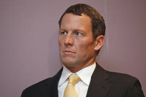 photo -   FILE - In this Feb. 28, 2011 file photo,Lance Armstrong sits during a news conference at the Cedars-Sinai Hospital in Los Angeles. The IOC formally opened an investigation Thursday, Nov. 1, 2012, that could result in Lance Armstrong losing his Olympic bronze medal for doping. Cycling's governing body, the UCI, last week formally stripped Armstrong of his seven Tour de France titles from 1999-2005. Armstrong could also lose the bronze medal he won in the road time trial at the 2000 Sydney Olympics. (AP Photo/Damian Dovarganes)
