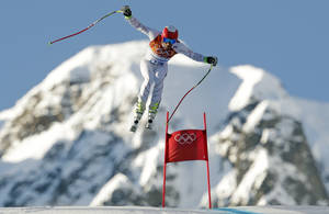Photo - United States' Bode Miller makes a jump during men's downhill combined training at the Sochi 2014 Winter Olympics, Thursday, Feb. 13, 2014, in Krasnaya Polyana, Russia.  (AP Photo/Charles Krupa)