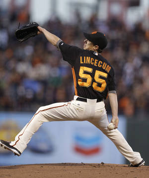 Photo - San Francisco Giants' Tim Lincecum works against the Oakland Athletics in the first inning of an exhibition spring training baseball game, Thursday, March 28, 2013, in San Francisco. (AP Photo/Ben Margot)