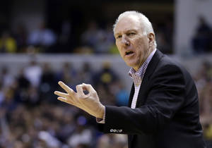 Photo - San Antonio Spurs head coach Gregg Popovich looks for a three second call in the first half of an NBA basketball game against the Indiana Pacers in Indianapolis, Monday, March 31, 2014.  (AP Photo/Michael Conroy)