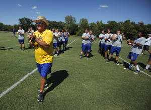 Photo - Dale Patterson, head coach and athletic director at NEO, starts football practice at Northeastern Oklahoma A&M College in Miami, Okla., Wednesday, July 18, 2012.  Photo by Garett Fisbeck, The Oklahoman