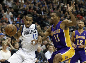Photo - Dallas Mavericks' Monta Ellis (11) attempts to get to the basket as Los Angeles Lakers' Wesley Johnson (11) defends in the second half of an NBA basketball game, Tuesday, Jan. 7, 2014, in Dallas. The Mavericks won 110-97. (AP Photo/Tony Gutierrez)