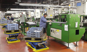 photo - At the TDK Ferrites Corp. plant in Shawnee, 250 employees manufacture ferrites, which are sold mostly to clients the automobile industry to help motor windshield wipers, motorized seats and more on cars. PHOTO BY DAVID MCDANIEL <strong>David McDaniel</strong>