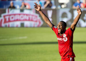 Photo - Toronto FC defender Doneil Henry reacts at game end after scoring the game winning goal against the Columbus Crew during second half MLS soccer action in Toronto on Saturday May 31, 2014. (AP Photo/The Canadian Press, Nathan Denette)
