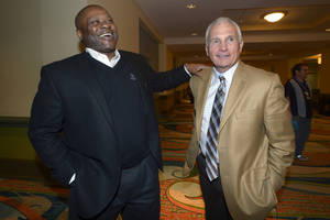 Photo - Seattle Mariners manager Lloyd McClendon, left, and New York Mets manager Terry Collins share a laugh at baseball's winter meetings in Lake Buena Vista, Fla., Wednesday, Dec. 11, 2013.(AP Photo/Phelan M. Ebenhack)