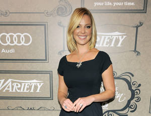 """Photo - FILE - In this Oct. 5, 2012 file photo, actress Katherine Heigl poses at Variety's 4th annual Power of Women event in Beverly Hills, Calif. Heigl will star as a CIA analyst in the new NBC series """"State of Affairs"""" also starring Alfre Woodard as the U.S. president.  (Photo by Chris Pizzello/Invision/AP, File)"""