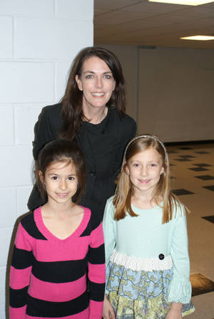 Photo - Clegern Elementary School second-graders Amy Meta, left, and Channing Hill, who won first place in the elementary category in the Love's Creative SPARKS! contest, are pictured with Clegern enrichment teacher Diane Clarke. PHOTO PROVIDED BY EDMOND PUBLIC SCHOOLS    <strong></strong>