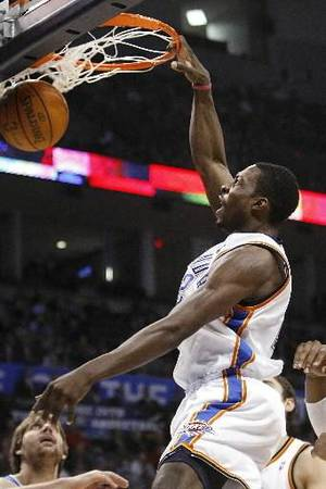 Photo - Oklahoma City Thunder forward  Jeff  Green slams down a dunk during the Thunder - Hornets game March 10, 2010 in the Ford Center in Oklahoma City. BY HUGH SCOTT
