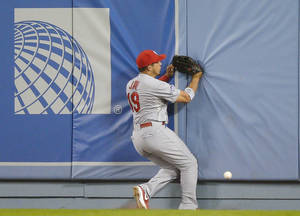 Photo - St. Louis Cardinals' Jon Jay can't come up with a ball hit by Los Angeles Dodgers' A.J. Ellis during the fifth inning of Game 3 of the National League baseball championship series, Monday, Oct. 14, 2013, in Los Angeles. (AP Photo/Mark J. Terrill)