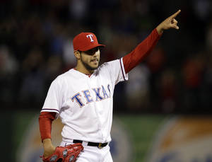 Photo - Texas Rangers' Martin Perez celebrates after getting the final out against the Chicago White Sox in a baseball game, Friday, April 18, 2014, in Arlington, Texas. Perez threw a three-hitter in the 12-0 Rangers win. (AP Photo/Tony Gutierrez)