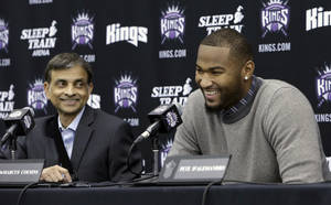 Photo - Sacramento Kings majority owner Vivek Ranadive and Kings center DeMarcus Cousins laugh during a news conference to announce Cousins' signing of four-year contract extension, in Sacramento, Calif., Monday, Sept.30, 2013.  (AP Photo/Rich Pedroncelli)