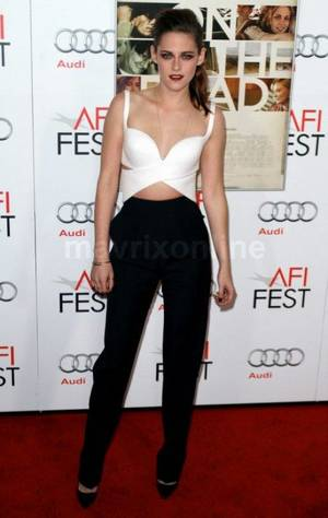 "Photo - Kristen Stewart's recent appearance in Balenciaga at a screening for ""On the Road"" at the AFI Fest was of particular significance. It was refreshing to see Stewart in menswear-reminiscent attire — the jumpsuit was sort of a sexy cutout tuxedo."