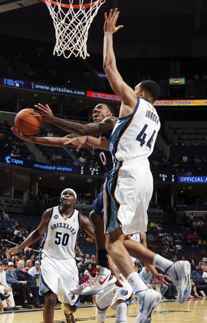 Photo -   Atlanta Hawks guard Jeff Teague (0) shoots and is fouled by Memphis Grizzlies forward Jerome Jordan (44) in the second half of an NBA basketball game, Sunday, Oct. 14, 2012, in Memphis, Tenn. The Grizzlies won 110-102. (AP Photo/Nikki Boertman)