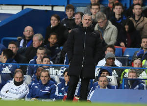 Photo - Chelsea manager Jose Mourinho watches the English Premier League soccer match between Chelsea and Crystal Palace at Stamford Bridge stadium in London Saturday, Dec. 14, 2013. (AP Photo/Alastair Grant)