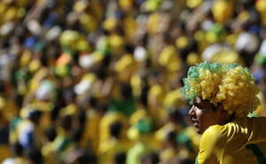 Photo - A Brazil soccer fan watches his team's World Cup round of 16 match against Chile at Mineirao Stadium in Belo Horizonte, Brazil, Saturday, June 28, 2014. Brazil won the match 3-2 on penalties after the match ended 1-1. (AP Photo/Petr David Josek)