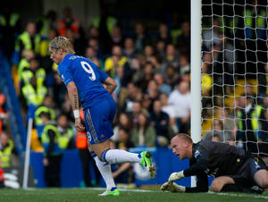 photo -   Chelsea's Fernando Torres, left, reacts after scoring against Norwich City during their English Premier League soccer match at the Stamford Bridge Stadium, London, Saturday, Oct. 6, 2012. (AP Photo/Tom Hevezi)