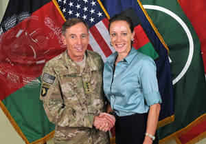"Photo -   This July 13, 2011, photo made available on the International Security Assistance Force's Flickr website shows the former Commander of International Security Assistance Force and U.S. Forces-Afghanistan Gen. Davis Petraeus, left, shaking hands with Paula Broadwell, co-author of ""All In: The Education of General David Petraeus.""As details emerge about Petraeus' extramarital affair with his biographer, Broadwell, including a second woman who allegedly received threatening emails from the author, members of Congress say they want to know exactly when the now ex-CIA director and retired general popped up in the FBI inquiry, whether national security was compromised and why they weren't told sooner. (AP Photo/ISAF)"