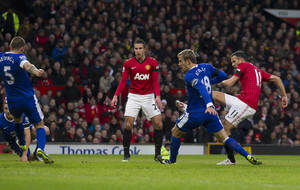 photo - Manchester United's Ryan Giggs, right, scores against Everton during their English Premier League soccer match at Old Trafford Stadium, Manchester, England, Sunday Feb. 10, 2013. (AP Photo/Jon Super)