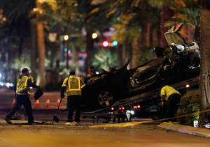 Photo - Tow truck drivers clean up and tow away cars involved in a drive-by shooting on Las Vegas Boulevard in Las Vegas Thursday, Feb. 21, 2013.  (AP Photo/Las Vegas Review-Journal, John Locher) LOCAL TV OUT; LOCAL INTERNET OUT; LAS VEGAS SUN OUT