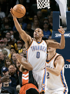 Photo - Oklahoma City guard Russell Westbrook steals the ball from Toronto's Jarrett Jack during Sunday's game. Photo by John Clanton, The Oklahoman
