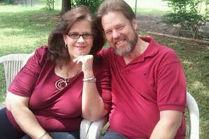 Photo - Robert Horton (right) and his wife Lisa, who had been married 30 years. Horton, 53, was shot and killed March 23 outside a Papa John's Pizza in Tulsa while delivering pizza dough. Courtesy