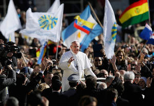 Photo - Pope Francis waves to crowds as he arrives to his inauguration Mass in St. Peter's Square at the Vatican, Tuesday, March 19, 2013. (AP Photo/Gregorio Borgia)