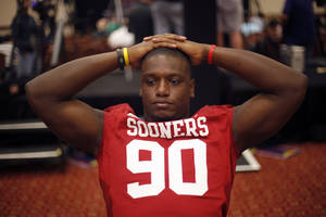 photo - OU / COLLEGE FOOTBALL: Oklahoma Sooners' David King (90) talks with the media during a University of Oklahoma media day for the Insight bowl at the Camelback Inn in Paradise Valley, Ariz.,  Wednesday, Dec. 28, 2011. Photo by Sarah Phipps, The Oklahoman